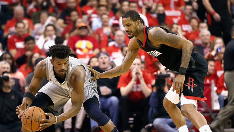 HOUSTON, TX - APRIL 18: Jimmy Butler #23 of the Minnesota Timberwolves is defended by Trevor Ariza #1 of the Houston Rockets during Game Two of the first round of the Western Conference playoffs at Toyota Center on April 18, 2018 in Houston, Texas. NOTE TO USER: User expressly acknowledges and agrees that, by downloading and or using this photograph, User is consenting to the terms and conditions of the Getty Images License Agreement. (Photo by Bob Levey/Getty Images)