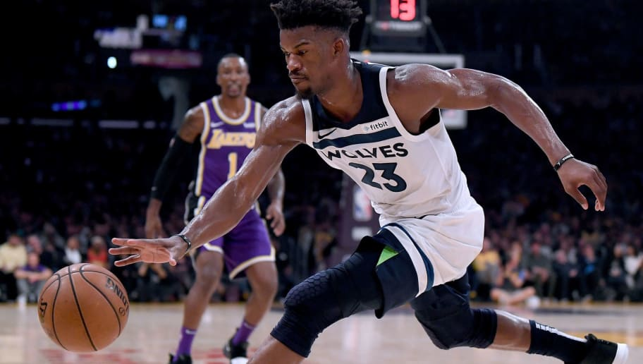 LOS ANGELES, CA - NOVEMBER 07:  Jimmy Butler #23 of the Minnesota Timberwolves reaches for a loose ball during a 114-110 loss to the Los Angeles Lakers at Staples Center on November 7, 2018 in Los Angeles, California.  NOTE TO USER: User expressly acknowledges and agrees that, by downloading and or using this photograph, User is consenting to the terms and conditions of the Getty Images License Agreement.  (Photo by Harry How/Getty Images)