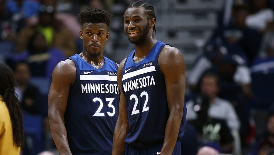 NEW ORLEANS, LA - NOVEMBER 29:  Andrew Wiggins #22 of the Minnesota Timberwolves and Jimmy Butler #23 react during the second half of a game against the New Orleans Pelicans at the Smoothie King Center on November 29, 2017 in New Orleans, Louisiana. NOTE TO USER: User expressly acknowledges and agrees that, by downloading and or using this Photograph, user is consenting to the terms and conditions of the Getty Images License Agreement.  (Photo by Jonathan Bachman/Getty Images)