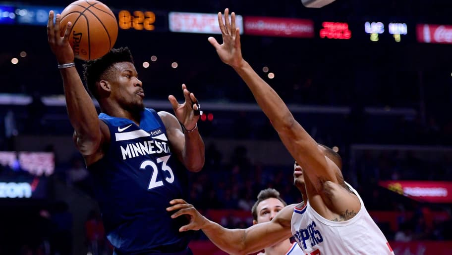 LOS ANGELES, CA - DECEMBER 06:  Jimmy Butler #23 of the Minnesota Timberwolves passes around Wesley Johnson #33 and Danilo Gallinari #8 of the LA Clippers during the first half at Staples Center on December 6, 2017 in Los Angeles, California.  (Photo by Harry How/Getty Images)