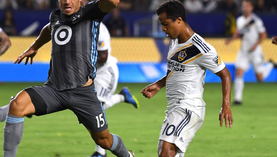 CARSON, CA - AUGUST 11: Michael Boxall #15 of Minnesota United defends Giovani dos Santos #10 of the Los Angeles Galaxy in the game at StubHub Center on August 11, 2018 in Carson, California.  (Photo by Jayne Kamin-Oncea/Getty Images)