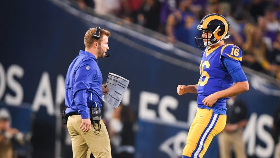 LOS ANGELES, CA - SEPTEMBER 27: Quarterback Jared Goff #16 of the Los Angeles Rams speaks to head coach Sean McVay during the second quarter at Los Angeles Memorial Coliseum on September 27, 2018 in Los Angeles, California. (Photo by Harry How/Getty Images)