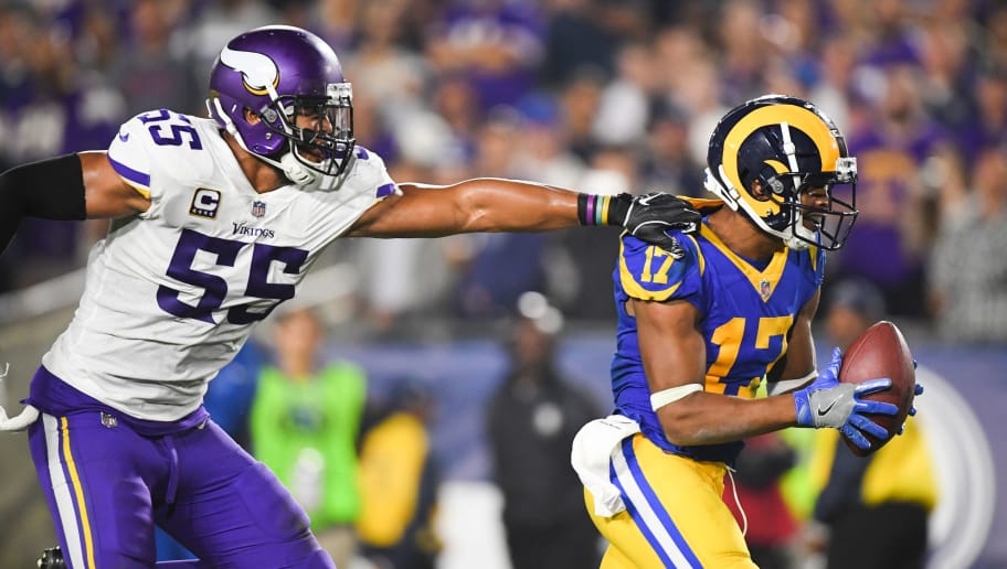 LOS ANGELES, CA - SEPTEMBER 27: Wide receiver Robert Woods #17 of the Los Angeles Rams makes a catch in front of linebacker Anthony Barr #55 of the Minnesota Vikings for a touchdown to lead 38-28 in the third quarter at Los Angeles Memorial Coliseum on September 27, 2018 in Los Angeles, California. (Photo by Harry How/Getty Images)