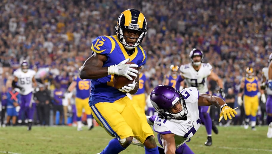 LOS ANGELES, CA - SEPTEMBER 27:  Brandin Cooks #12 of the Los Angeles Rams makes a catch in front of Mike Hughes #21 of the Minnesota Vikings at Los Angeles Memorial Coliseum on September 27, 2018 in Los Angeles, California.  (Photo by Harry How/Getty Images)