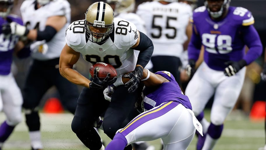 NEW ORLEANS, LA - SEPTEMBER 21:  Jimmy Graham #80 of the New Orleans Saints avoids a tackle by Josh Robinson #21 of the Minnesota Vikings during the first quarter of a game at the Mercedes-Benz Superdome on September 21, 2014 in New Orleans, Louisiana.  (Photo by Wesley Hitt/Getty Images)