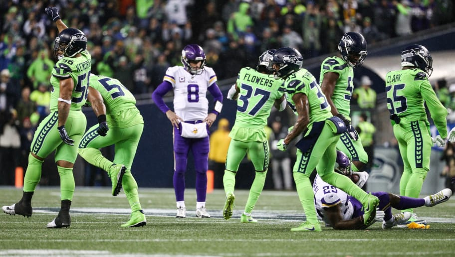 SEATTLE, WA - DECEMBER 10: The Seattle Seahawks defense celebrates a 4th down stop in the third quarter against the Minnesota Vikings at CenturyLink Field on December 10, 2018 in Seattle, Washington. (Photo by Abbie Parr/Getty Images)