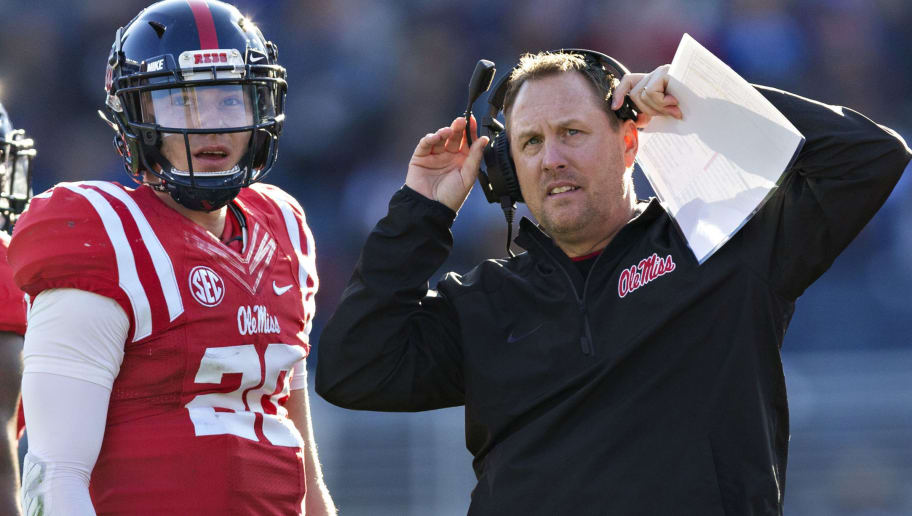 OXFORD, MS - NOVEMBER 26:  Head Coach Hugh Freeze talks with Shea Patterson #20 of the Mississippi Rebels during a game against the Mississippi State Bulldogs at Vaught-Hemingway Stadium on November 26, 2016 in Oxford, Mississippi.  The Bulldogs defeated the Rebels 55-20.  (Photo by Wesley Hitt/Getty Images)