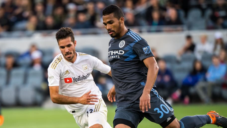 LOS ANGELES, CA - MAY 13: Benny Feilhaber #33 of Los Angeles FC and Yangel Herrera #30 of New York City FCduring Los Angeles FC's MLS match against New York City FC at the Banc of California Stadium on May 13, 2018 in Los Angeles, California. The match ended in a 2-2 tie (Photo by Shaun Clark/Getty Images)