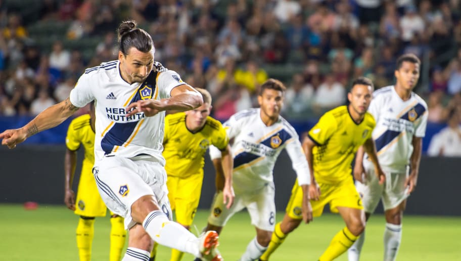 CARSON, CA - JULY 7:   Zlatan Ibrahimovic #9 of Los Angeles Galaxy scores a penalty kick during the Los Angeles Galaxy's MLS match against Columbus Crew at the StubHub Center on July 7, 2018 in Carson, California.  Los Angeles Galaxy won the match 4-0 (Photo by Shaun Clark/Getty Images)