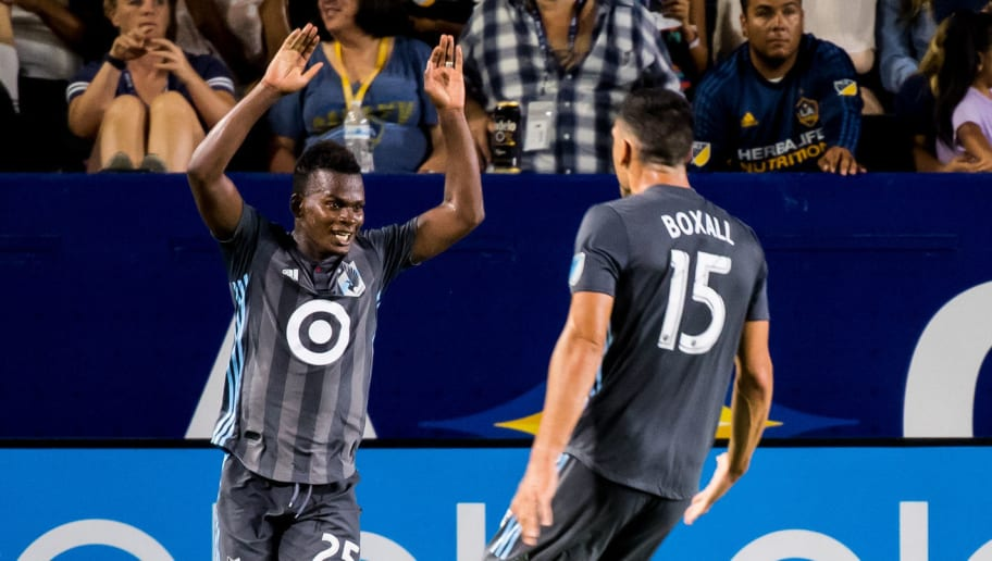 CARSON, CA - AUGUST 11: Michael Boxall #15 of Minnesota United celebrates his goal with Carlos Darwin Quintero #25 of Minnesota United  during the Los Angeles Galaxy's MLS match against Minnesota United at the StubHub Center on August 11, 2018 in Carson, California.  The match ended in a 2-2 tie. (Photo by Shaun Clark/Getty Images)