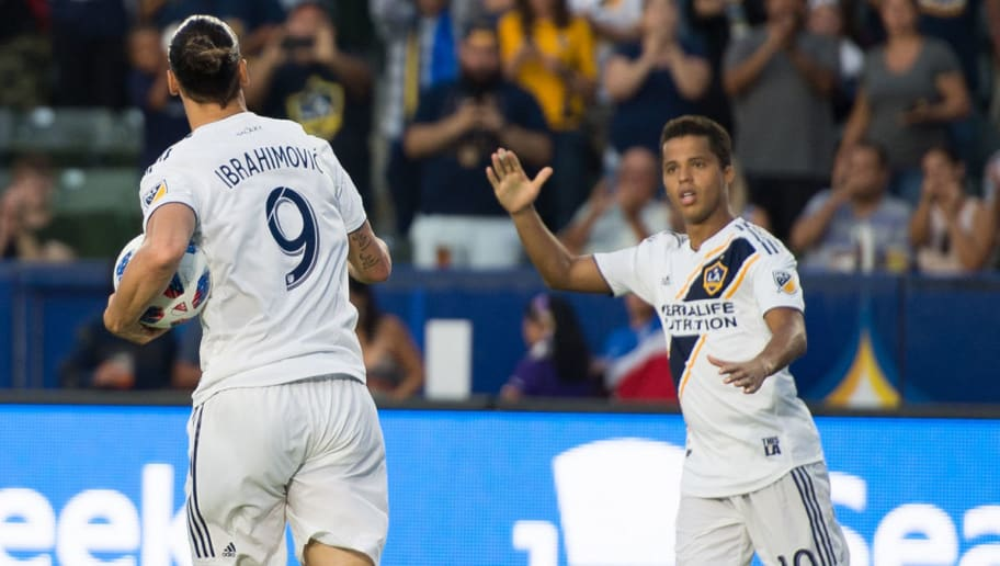 CARSON, CA - JULY 29:   Giovani dos Santos #10 of Los Angeles Galaxy congratulates Zlatan Ibrahimovic #9 on his first goal against Orlando City SC at the StubHub Center on July 29, 2018 in Carson, California.  Los Angeles Galaxy won the match 4-3 (Photo by Shaun Clark/Getty Images)