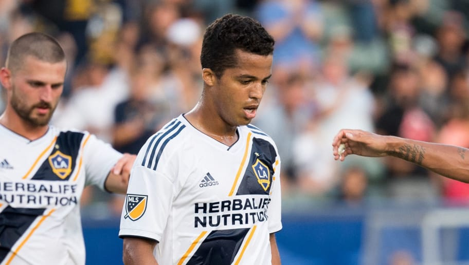 CARSON, CA - JULY 29:  Jonathan dos Santos #8 of Los Angeles Galaxy congratulates his brother Giovani dos Santos #10 on his goal against Orlando City SC at the StubHub Center on July 29, 2018 in Carson, California.  Los Angeles Galaxy won the match 4-3 (Photo by Shaun Clark/Getty Images)
