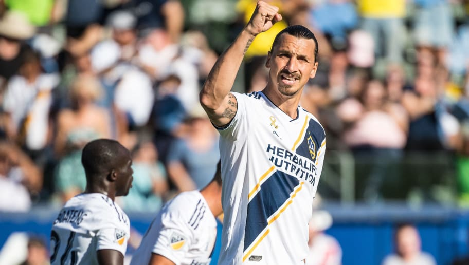 CARSON, CA - SEPTEMBER 23: Zlatan Ibrahimovic #9 of Los Angeles Galaxy celebrates his penalty kick goal during the Los Angeles Galaxy's MLS match against Seattle Sounders at the StubHub Center on September 23, 2018 in Carson, California.  Los Angeles Galaxy won the match 3-0(Photo by Shaun Clark/Getty Images)