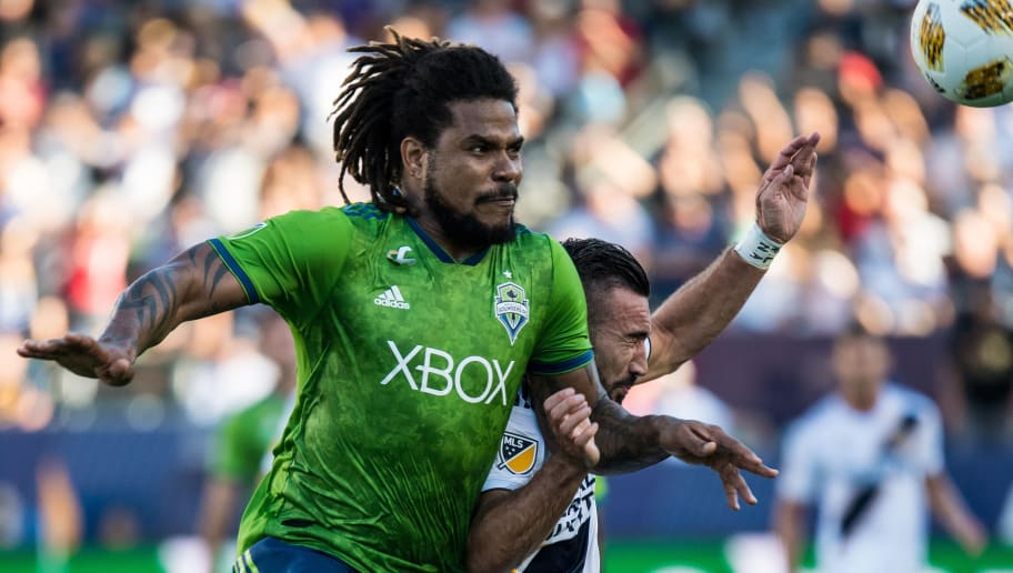 CARSON, CA - SEPTEMBER 23: Roman Torres #29 of Seattle Sounders defends against Romain Alessandrini #7 of Los Angeles Galaxy during the Los Angeles Galaxy's MLS match against Seattle Sounders at the StubHub Center on September 23, 2018 in Carson, California.  Los Angeles Galaxy won the match 3-0(Photo by Shaun Clark/Getty Images)
