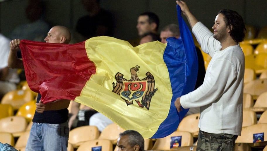 Moldovan fans wave their national flag d
