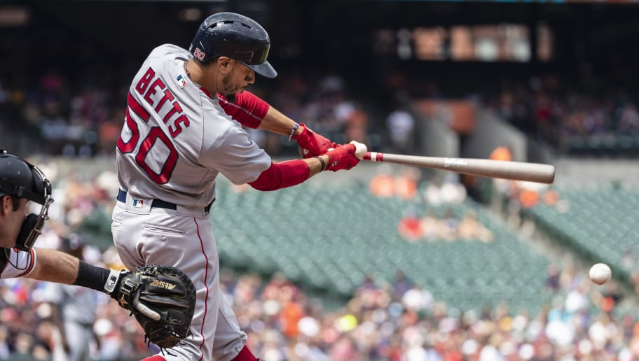 BALTIMORE, MD - AUGUST 12: Mookie Betts #50 of the Boston Red Sox at bat against the Baltimore Orioles during the fifth inning at Oriole Park at Camden Yards on August 12, 2018 in Baltimore, Maryland. (Photo by Scott Taetsch/Getty Images)