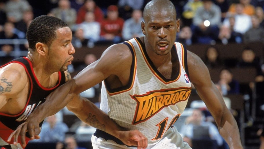 12 Dec 2000:  Mookie Blaylock #10 of the Golden State Warriors dribbles the ball as he is guarded by Damon Stoudamire #3 of the Portland Trail Blazers at The Arena of Oakland in California. The Trail Blazers defeated the Warriors 101-92. NOTE TO USER: It is expressly understood that the only rights Allsport are offering to license in this Photograph are one-time, non-exclusive editorial rights. No advertising or commercial uses of any kind may be made of Allsport photos. User acknowledges that it is aware that Allsport is an editorial sports agency and that NO RELEASES OF ANY TYPE ARE OBTAINED from the subjects contained in the photographs.Mandatory Credit: Jed Jacobsohn  /Allsport