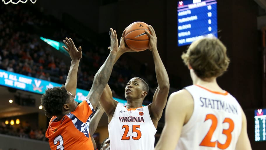 CHARLOTTESVILLE, VA - DECEMBER 03: Mamadi Diakite #25 of the Virginia Cavaliers shoots over Victor Curry #3 of the Morgan State Bears in the second half during a game at John Paul Jones Arena on December 3, 2018 in Charlottesville, Virginia. (Photo by Ryan M. Kelly/Getty Images)