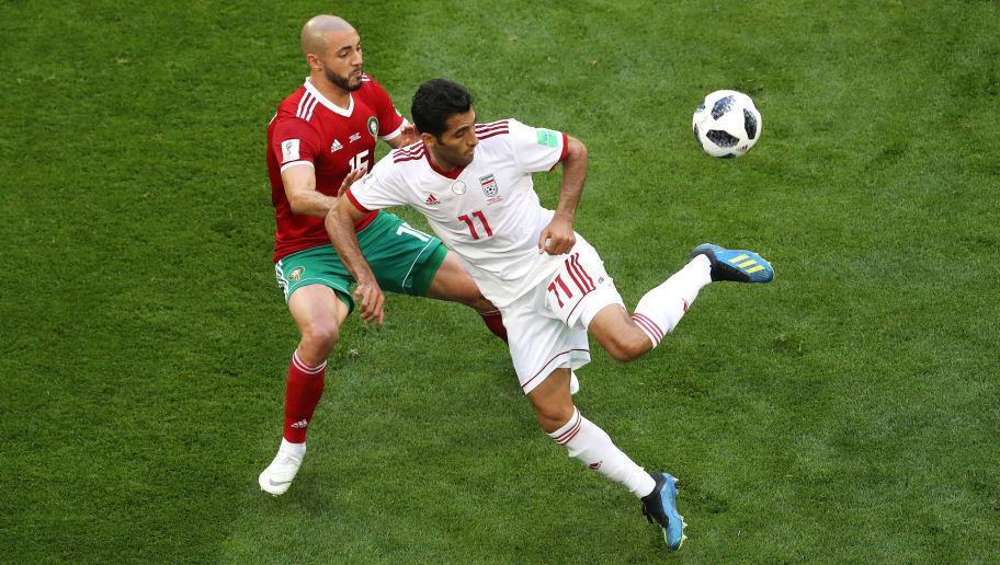 SAINT PETERSBURG, RUSSIA - JUNE 15:  Vahid Amiri of Iran cb Noureddine Amrabat of Morocco during the 2018 FIFA World Cup Russia group B match between Morocco and Iran at Saint Petersburg Stadium on June 15, 2018 in Saint Petersburg, Russia.  (Photo by Francois Nel/Getty Images)
