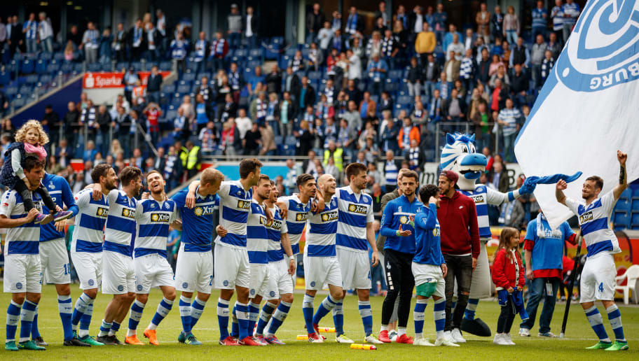 DUISBURG, GERMANY - APRIL 29:  Players of Duisburg celebrate after winning the Second Bundesliga match between MSV Duisburg and SSV Jahn Regensburg at Schauinsland-Reisen-Arena on April 29, 2018 in Duisburg, Germany.  (Photo by Lars Baron/Bongarts/Getty Images)