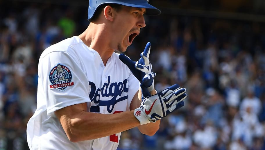 LOS ANGELES, CA - OCTOBER 01:  Walker Buehler #21 of the Los Angeles Dodgers reacts as he runs to first after hitting a RBI single in the sixth inning of the game against the Colorado Rockies at Dodger Stadium on October 1, 2018 in Los Angeles, California.  (Photo by Jayne Kamin-Oncea/Getty Images)