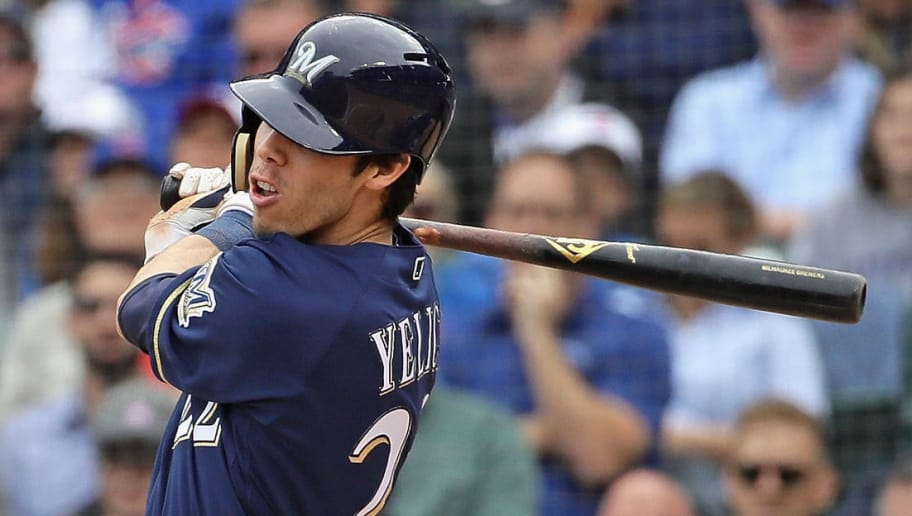 CHICAGO, IL - OCTOBER 01:    Christian Yelich #22 of the Milwaukee Brewers hits a run scoring single in the 3rd inning against the Chicago Cubs during the National League Tiebreaker Game at Wrigley Field on October 1, 2018 in Chicago, Illinois. (Photo by Jonathan Daniel/Getty Images)
