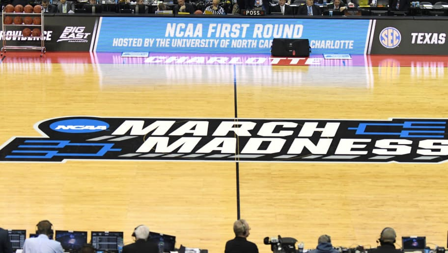CHARLOTTE, NC - MARCH 16: The NCAA March Madness logo on the floor before the first round of the 2018 NCAA Men's Basketball Tournament between the Texas A&M Aggies and the Providence Friars at the Spectrum Center on March 16, 2018 in Charlotte, North Carolina. The Aggies won 73-69.  (Photo by Mitchell Layton/Getty Images)