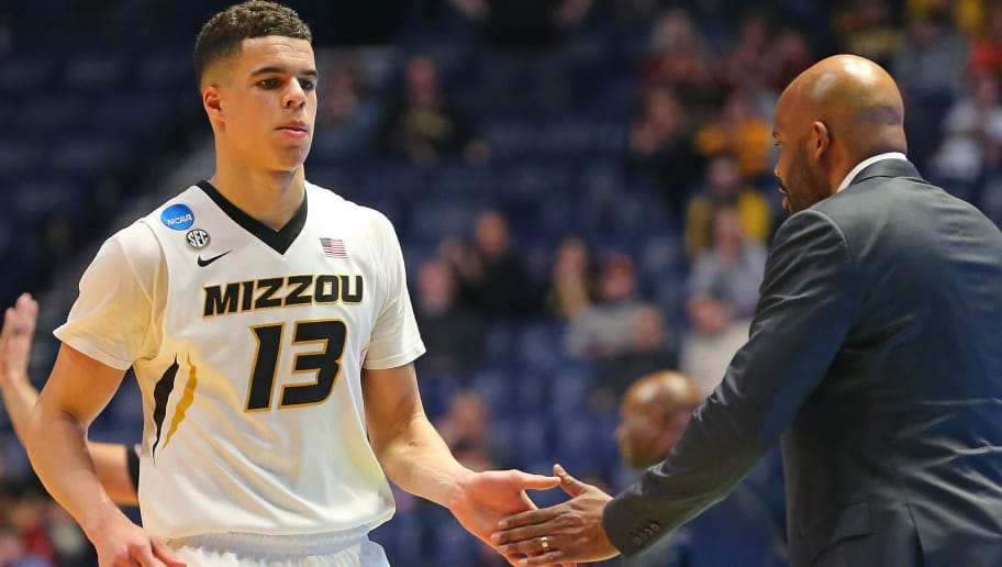 NASHVILLE, TN - MARCH 16:  Michael Porter Jr. #13 of the Missouri Tigers high fives head coach Cuonzo Martin as he comes off the court during a game against the Florida State Seminoles during the first round of the 2018 NCAA Men's Basketball Tournament at Bridgestone Arena on March 16, 2018 in Nashville, Tennessee.  (Photo by Frederick Breedon/Getty Images)