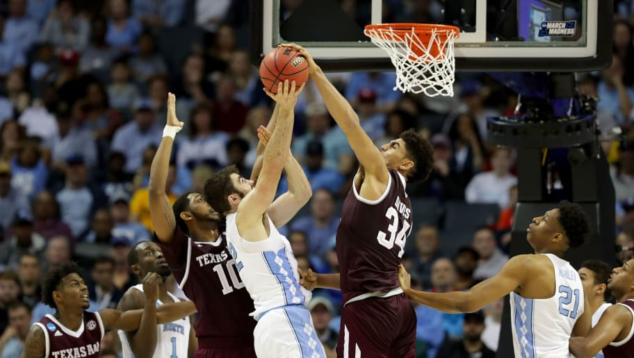 CHARLOTTE, NC - MARCH 18: Tyler Davis #34 of the Texas A&M Aggies blocks a shot by Luke Maye #32 of the North Carolina Tar Heels during the second round of the 2018 NCAA Men's Basketball Tournament at Spectrum Center on March 18, 2018 in Charlotte, North Carolina.  (Photo by Streeter Lecka/Getty Images)