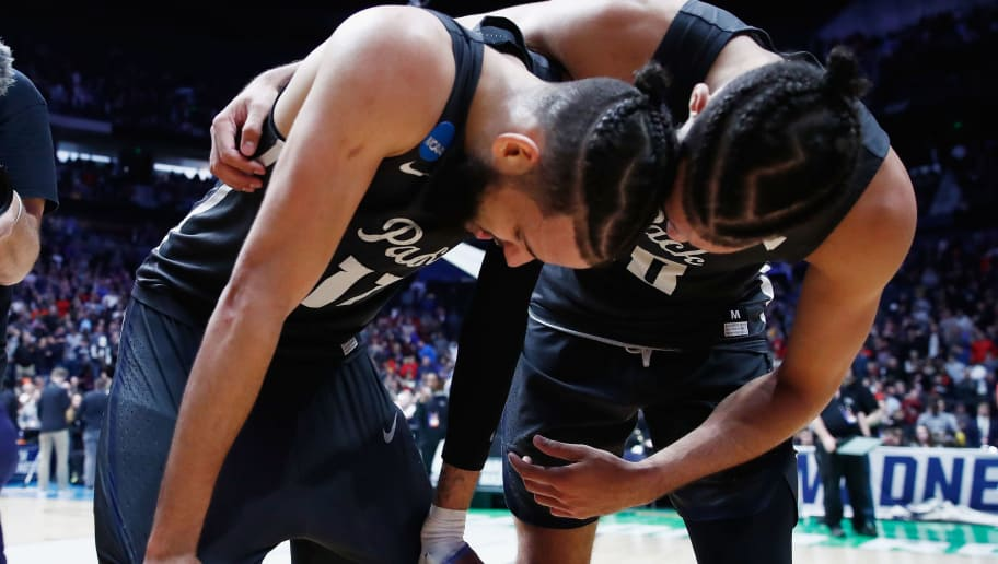 NASHVILLE, TN - MARCH 18:  Caleb Martin #10 celebrates with Cody Martin #11 of the Nevada Wolf Pack after defeating the Cincinnati Bearcats in the second round of the 2018 Men's NCAA Basketball Tournament at Bridgestone Arena on March 18, 2018 in Nashville, Tennessee.  (Photo by Andy Lyons/Getty Images)
