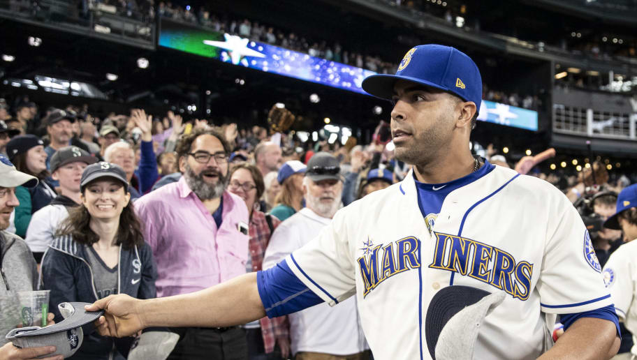 SEATTLE, WA - SEPTEMBER 30: Nelson Cruz #23 of the Seattle Mariners hands out souvenirs after the final game of the season against the Texas Rangers at Safeco Field on September 30, 2018 in Seattle, Washington. The Mariners won the game 3-1. (Photo by Stephen Brashear/Getty Images)