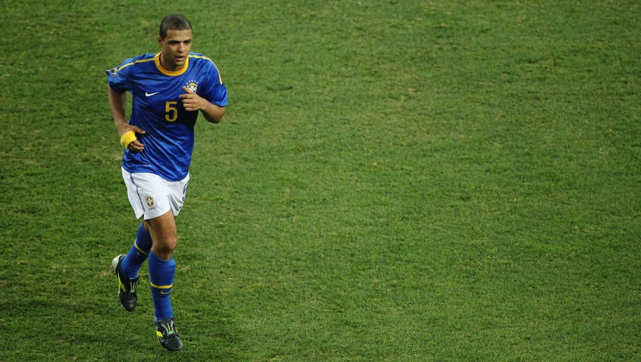 PORT ELIZABETH, SOUTH AFRICA - JULY 02:  Felipe Melo of Brazil walks off the pitch after being sent off following a tackle on Arjen Robben of the Netherlands during the 2010 FIFA World Cup South Africa Quarter Final match between Netherlands and Brazil at Nelson Mandela Bay Stadium on July 2, 2010 in Nelson Mandela Bay/Port Elizabeth, South Africa.  (Photo by Doug Pensinger/Getty Images)