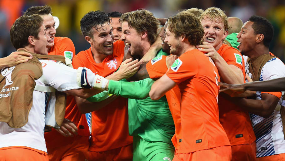 SALVADOR, BRAZIL - JULY 05:  Goalkeeper Tim Krul of the Netherlands celebrates with teammates after making a save in a penalty shootout to defeat Costa Rica during the 2014 FIFA World Cup Brazil Quarter Final match between the Netherlands and Costa Rica at Arena Fonte Nova on July 5, 2014 in Salvador, Brazil.  (Photo by Jamie McDonald/Getty Images)