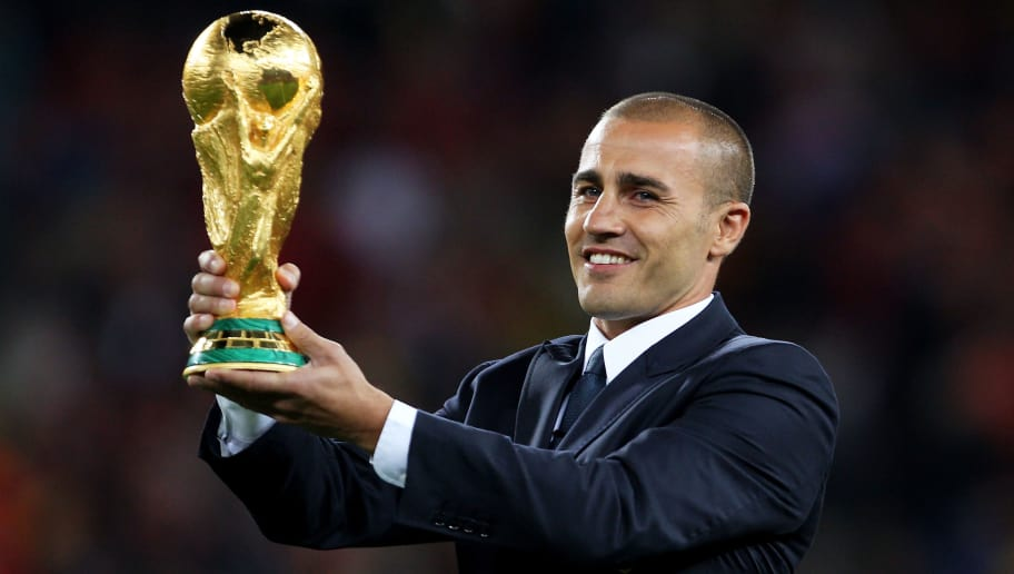 JOHANNESBURG, SOUTH AFRICA - JULY 11:  Captain of the 2006 FIFA World Cup winning team Fabio Cannavaro presents the World Cup on the pitch ahead of the 2010 FIFA World Cup South Africa Final match between Netherlands and Spain at Soccer City Stadium on July 11, 2010 in Johannesburg, South Africa.  (Photo by Clive Rose/Getty Images)