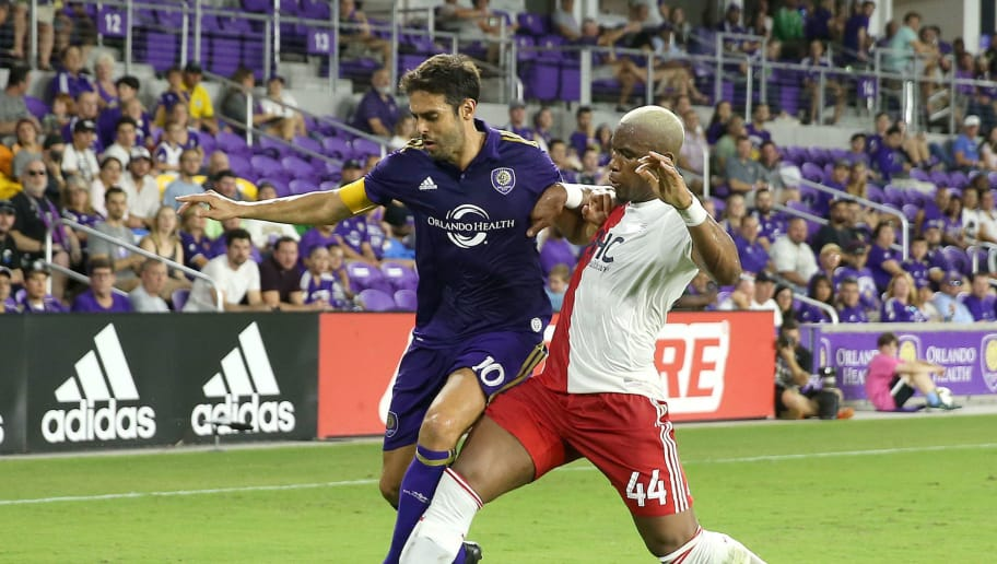 ORLANDO, FL - SEPTEMBER 27: Claude Dielna #44 of New England Revolution and Kaka #10 of Orlando City SC fight for the ball during a MLS soccer match at Orlando City Stadium on September 27, 2017 in Orlando, Florida. (Photo by Alex Menendez/Getty Images)
