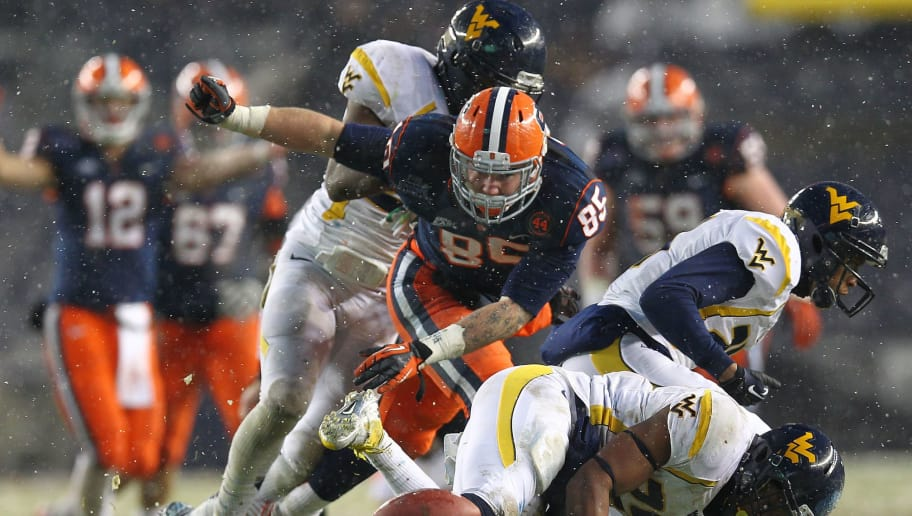 NEW YORK, NY - DECEMBER 29:  Beckett Wales #85 of the Syracuse Orange reaches for the ball against Cecil Level #24 and Darwin Cook #25 of the West Virginia Mountaineers during the New Era Pinstripe Bowl at Yankee Stadium on December 29, 2012 in the Bronx borough of New York City. (Photo by Nate Shron/Getty Images)