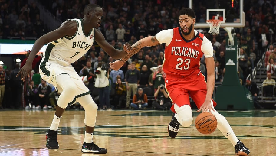 MILWAUKEE, WISCONSIN - DECEMBER 19:  Anthony Davis #23 of the New Orleans Pelicans drives around Thon Maker #7 of the Milwaukee Bucks during a game at Fiserv Forum on December 19, 2018 in Milwaukee, Wisconsin.  NOTE TO USER: User expressly acknowledges and agrees that, by downloading and or using this photograph, User is consenting to the terms and conditions of the Getty Images License Agreement. (Photo by Stacy Revere/Getty Images)