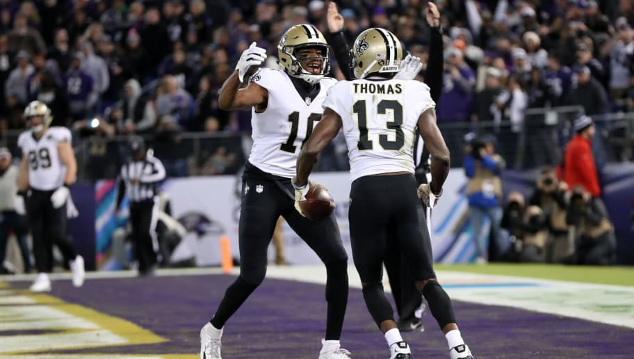 BALTIMORE, MD - OCTOBER 21: Wide Receiver Michael Thomas #13 of the New Orleans Saints celebrates with wide receiver Tre'Quan Smith #10 after scoring a touchdown in the fourth quarter against the Baltimore Ravens at M&T Bank Stadium on October 21, 2018 in Baltimore, Maryland. (Photo by Rob Carr/Getty Images)