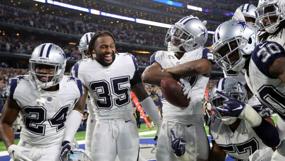 ARLINGTON, TEXAS - NOVEMBER 29: Chidobe Awuzie #24, Kavon Frazier #35 and other Dallas Cowboys celebrate the fourth quarter interception by Jourdan Lewis #27 against the New Orleans Saints at AT&T Stadium on November 29, 2018 in Arlington, Texas. (Photo by Richard Rodriguez/Getty Images)