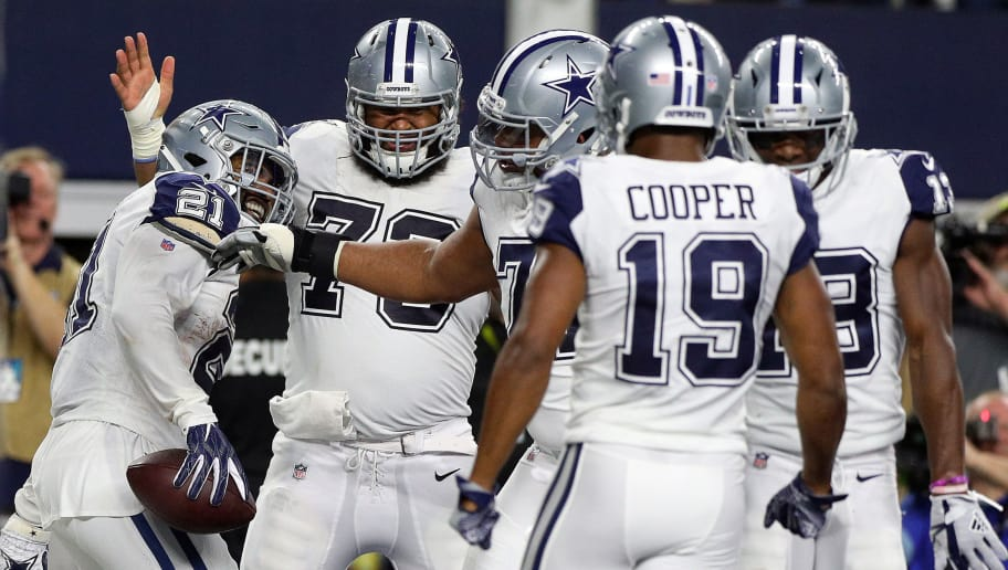 ARLINGTON, TEXAS - NOVEMBER 29: Ezekiel Elliott #21 of the Dallas Cowboys celebrates a first quarter touchdown with Joe Looney #73, La'el Collins #71, and Amari Cooper #19 at AT&T Stadium on November 29, 2018 in Arlington, Texas. (Photo by Richard Rodriguez/Getty Images)