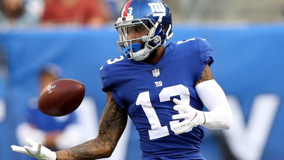 EAST RUTHERFORD, NJ - SEPTEMBER 30:  Odell Beckham #13 of the New York Giants bobbles a the ball but makes the catch in the second half against the New Orleans Saints on September 30,2018 at MetLife Stadium in East Rutherford, New Jersey.  (Photo by Elsa/Getty Images)