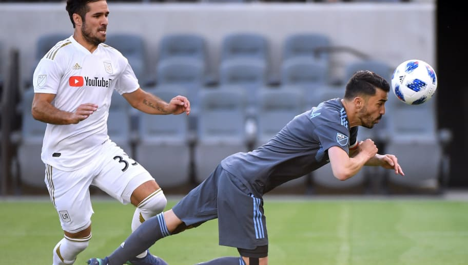 LOS ANGELES, CA - MAY 13:  David Villa #7 of New York City heads in his own rebound off of his penalty kick for a goal and a 1-0 lead in front of Benny Feilhaber #33 of Los Angeles FC during the first half at Banc of California Stadium on May 13, 2018 in Los Angeles, California.  (Photo by Harry How/Getty Images)
