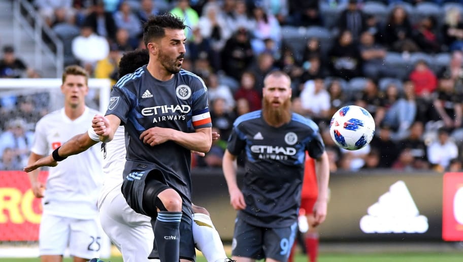 LOS ANGELES, CA - MAY 13:  David Villa #7 of New York City jumps to take a pass during the second half against Los Angeles FC at Banc of California Stadium on May 13, 2018 in Los Angeles, California.  The game ended 2-2.  (Photo by Harry How/Getty Images)