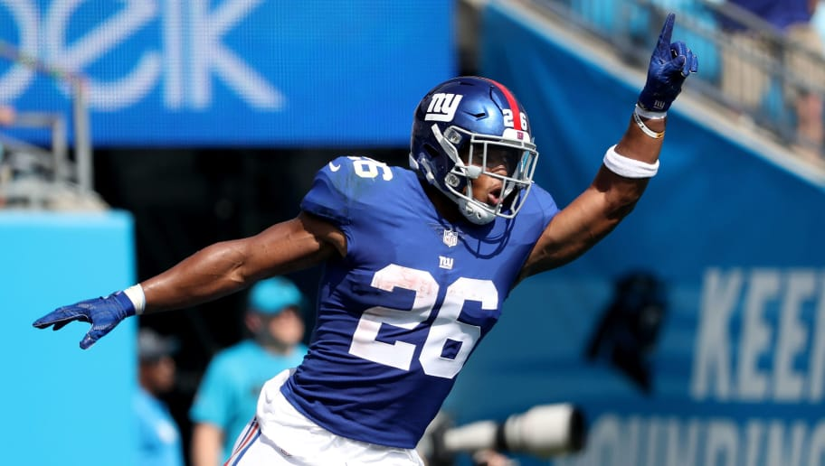 CHARLOTTE, NC - OCTOBER 07:  Saquon Barkley #26 of the New York Giants celebrates after scoring a touchdown against the Carolina Panthers during their game at Bank of America Stadium on October 7, 2018 in Charlotte, North Carolina.  (Photo by Streeter Lecka/Getty Images)