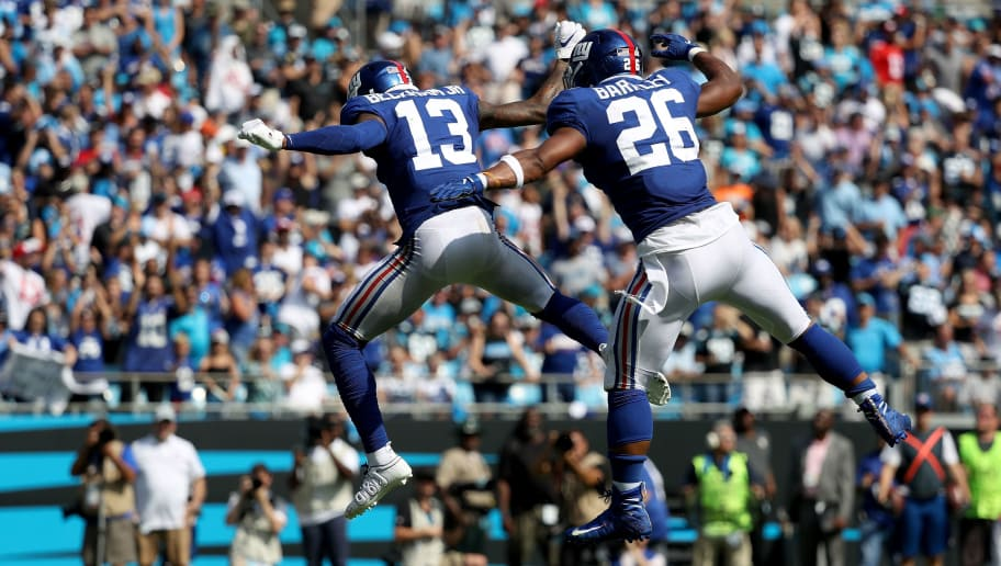 CHARLOTTE, NC - OCTOBER 07:  Teammates Odell Beckham Jr. #13 and Saquon Barkley #26 of the New York Giants celebrate after Beckham Jr. throws a touchdown to Barkley during their game at Bank of America Stadium on October 7, 2018 in Charlotte, North Carolina.  (Photo by Streeter Lecka/Getty Images)