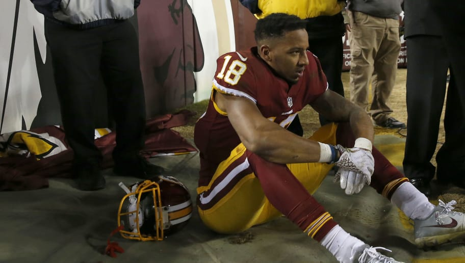 LANDOVER, MD - NOVEMBER 23: Wide receiver Josh Doctson #18 of the Washington Redskins sits on the sideline after catching a fourth quarter touchdown pass against the New York Giants at FedExField on November 23, 2017 in Landover, Maryland. (Photo by Rob Carr/Getty Images)