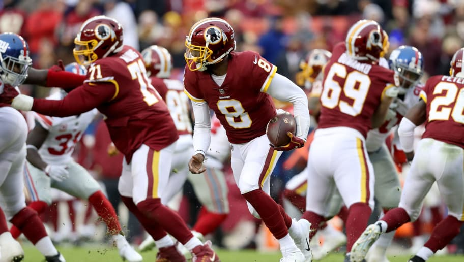LANDOVER, MARYLAND - DECEMBER 09: Quarterback Josh Johnson #8 of the Washington Redskins runs with the ball against the New York Giants in the second half at FedExField on December 09, 2018 in Landover, Maryland. (Photo by Rob Carr/Getty Images)