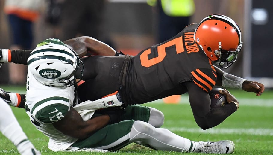 CLEVELAND, OH - SEPTEMBER 20:  Tyrod Taylor #5 of the Cleveland Browns is sacked by Darron Lee #58 of the New York Jets during the first quarter at FirstEnergy Stadium on September 20, 2018 in Cleveland, Ohio. (Photo by Jason Miller/Getty Images)