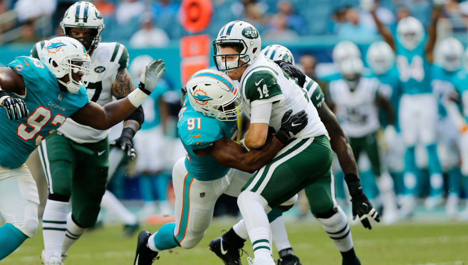 MIAMI, FL - NOVEMBER 04:  Cameron Wake #91 of the Miami Dolphins sacks Sam Darnold #14 of the New York Jets in the second quarter of their game at Hard Rock Stadium on November 4, 2018 in Miami, Florida.  (Photo by Michael Reaves/Getty Images)
