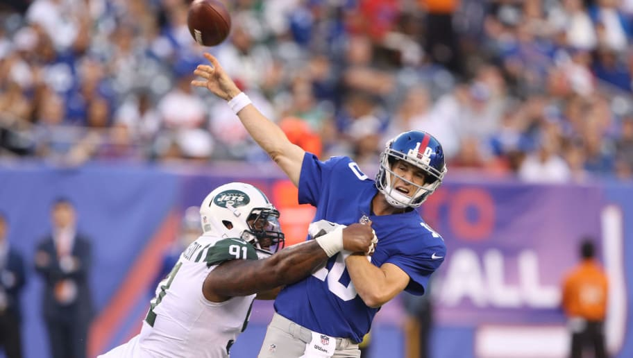 EAST RUTHERFORD, NJ - AUGUST 26: Defensive Lineman Sheldon Richardson #91 of the New York Jets pressures Quarterback Eli Manning #10 of the New York Giants during a preseason game on August 26, 2017 at MetLife Stadium in East Rutherford, New Jersey (Photo by Al Pereira/Getty Images)